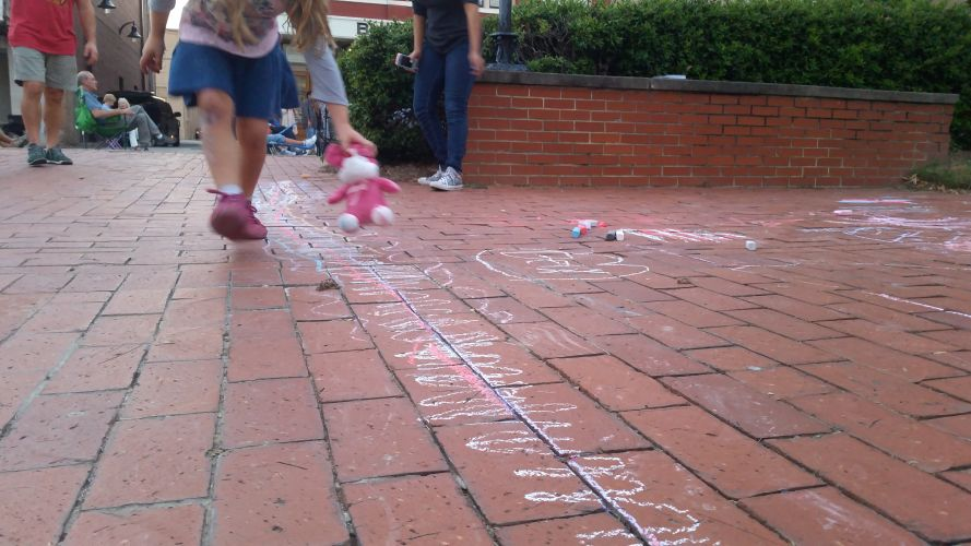kids enjoying side walk chalk at Alive Day