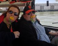 Joey driving Duck Boat with Jen side seat diving and quacking