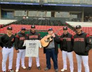 Kane County Cougars presenting Joey with team signed T-shirt