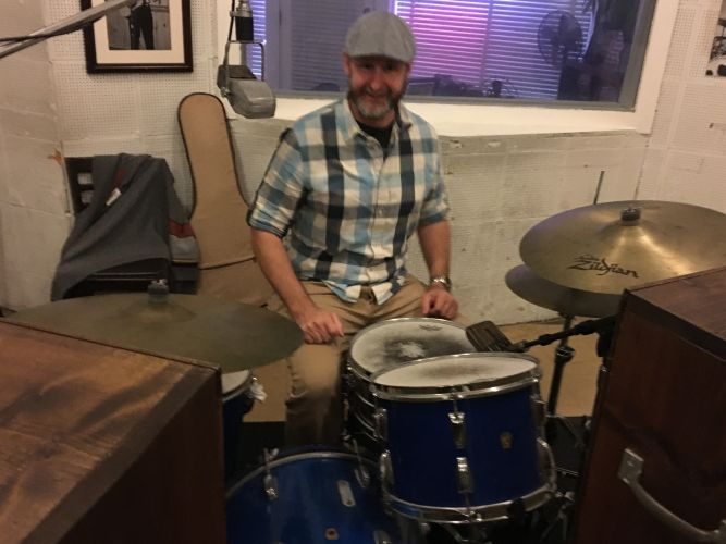 Charles at Sun Studio behind the U2 Rattle and Hum drum set